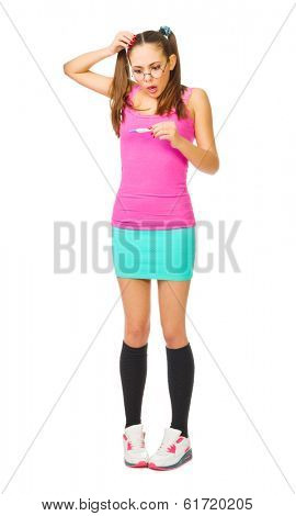 Worried girl with pregnancy test isolated