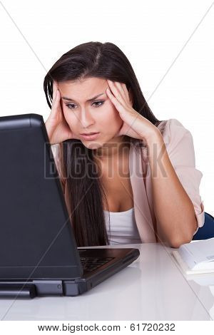 Unmotivated Woman Staring At Her Laptop