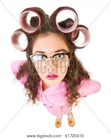 Funny housewife with curlers isolated