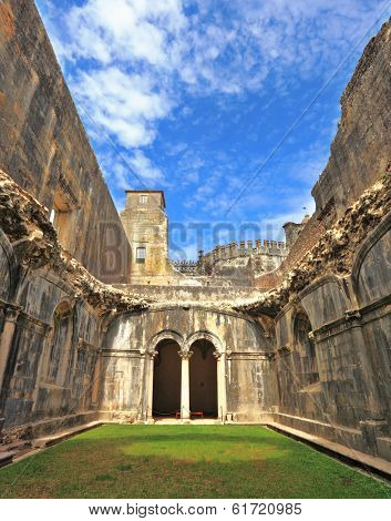 Palace of the Knights Templar in the small town of Tomar, Portugal. Beautiful green inner courtyard, surrounded by a fine building with a beautifully preserved architecture