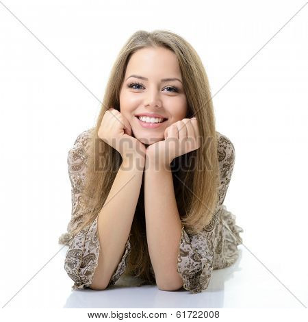 Beautiful happy blond girl lying and looking at camera. Isolated on white background
