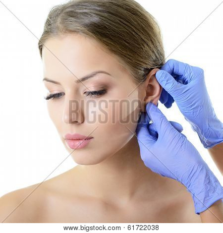 Young woman face with beauty treatment ear plastic isolated