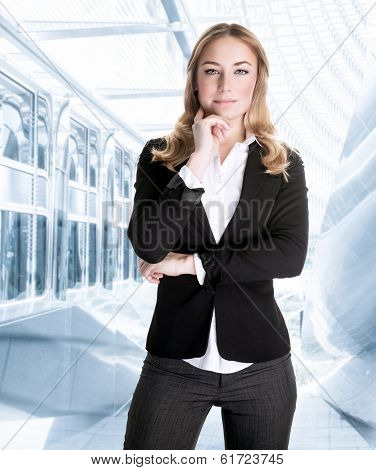 Successful business woman in the office, waiting for a meeting, beautiful young CEO of great corporation, careerism concept