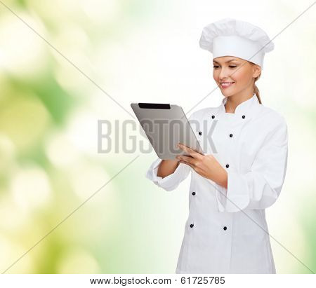 cooking, technology and food concept - smiling female chef, cook or baker with tablet pc computer
