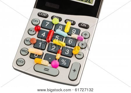 tablets lie on a calculator. symbolic photo for costs in medicine and pharmaceutical industry