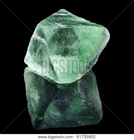 Green Fluorite with reflection on black surface background