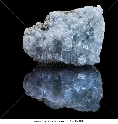 mineral Celestine with reflection on black surface background