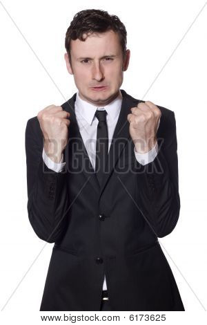 Angry Businessman Is Showing His Fists