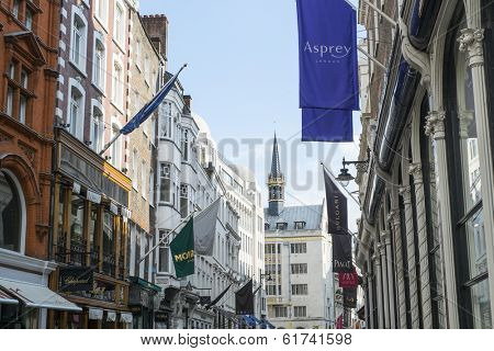 LONDON, UK - MARCH 01: Row of of banners for famous and expensive shops in New Bond Street. March 01, 2014 in London.
