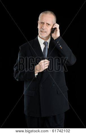 Worried Businessman on Phone