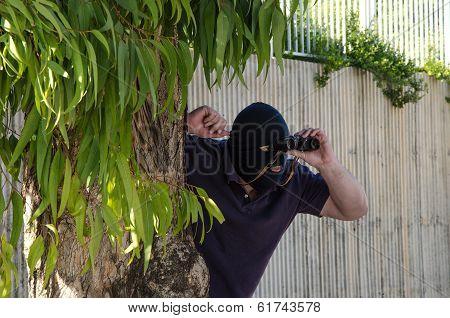 Footpad Looking Through Binoculars