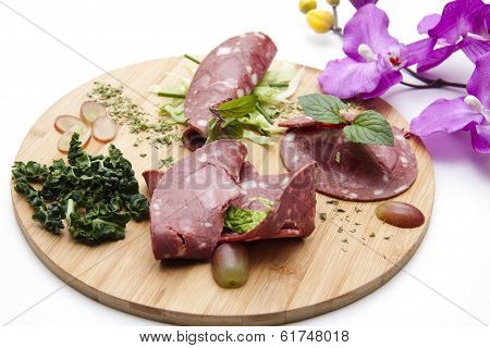 Fresh Sliced Blood Sausage with Fruits and Vegetables on edge board