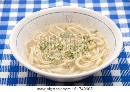 Noodle soup in porcelain bowl