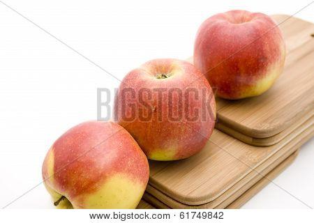 Fresh Red Apple on Edge Board