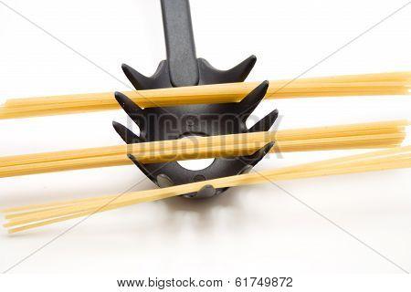 Spaghetti with spaghetti spoon