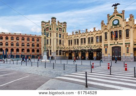 VALENCIA, SPAIN - JANUARY 14, 2014: City plaza and North Station - main railway station in Valencia, Spain, located in city center, opened in 1917 and declared Good of Cultural Heritage in 1987.