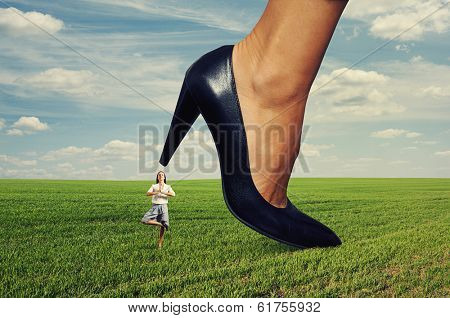calm yoga businesswoman under big heel at outdoor