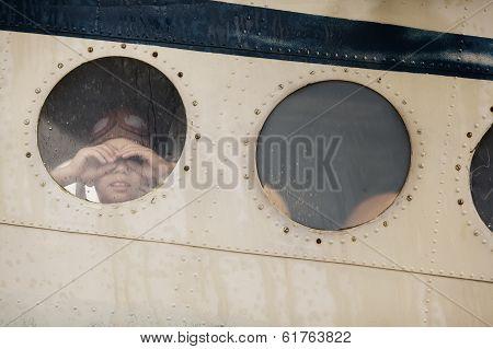 two boys in window of plane