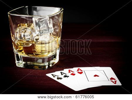 Poker Cards Near Wiskey Glass