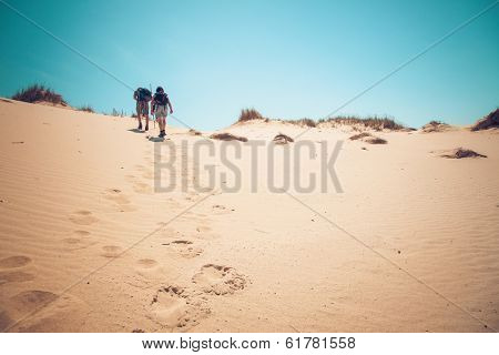 Senior couple walking up a hill.personal editting
