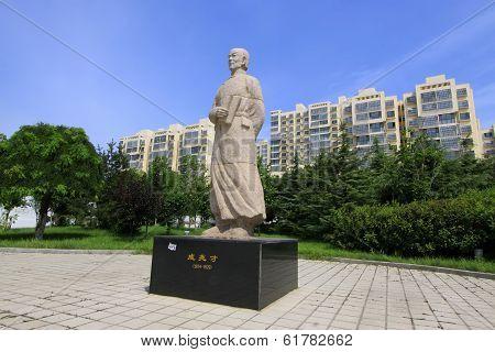 Figure Sculpture In A Park