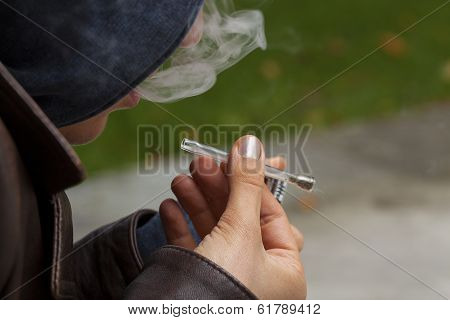 Young Boy Smoking Marijuana