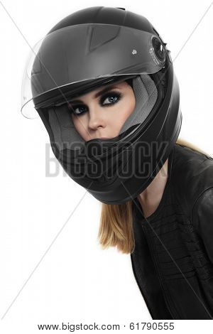 Portrait of young beautiful woman in biker helmet over white background