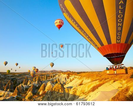 GOREME, TURKEY - AUGUST 25: Hot air balloon fly over Cappadocia on august 25, 2013 in Goreme, Cappadocia, Turkey.