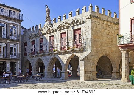 Guimaraes, Portugal - October 13, 2013: Old Town-Hall (Antigos Pacos do Concelho) in Oliveira Square in the Historical Center. Unesco World Heritage Site.