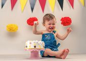 picture of crying boy  - Baby boy crying while eating his  birthday party cake - JPG