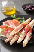 stock photo of antipasto  - prosciutto ham and grissini bread sticks - JPG