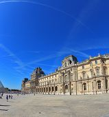 Paris, September 8: The world-famous Louvre - September 8, 2012 in Paris. Tourists take pictures of