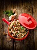 pic of edible mushroom  - tagliatelle with cep edible mushroom and bacon over casserole - JPG