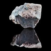 Dumortierite mineral with reflection on black surface background