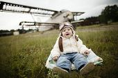 stock photo of bomber jacket  - sweet little baby dreaming of being pilot - JPG