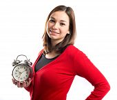 Happy Young Girl Holding An Antique Clock Over White Background