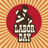 stock photo of labourer  - Happy Labor Day background with young worker holding a hammer on vintage background - JPG