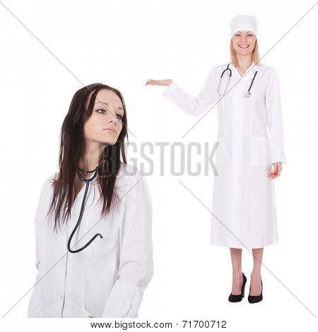 Standing woman doctor with stethoscope in a white robe. She points with a finger to the right part of an image. The place on the image to the right of her is empty for a text