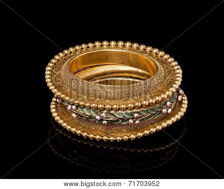 Close up of designer golden bracelet