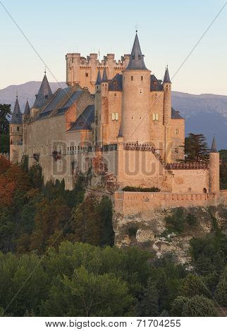 Castle And Trees At Sunset In Segovia. Alcazar.