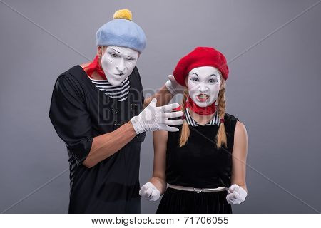 Couple of two funny mimes isolated on background
