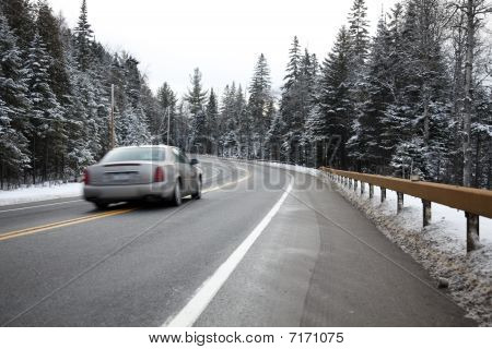 Speeding Car On A Winter Road