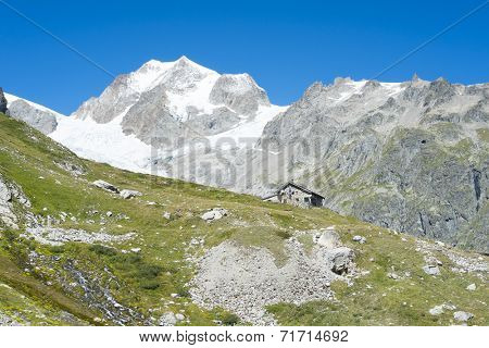 VAL VENY, ITALY - AUGUST 27: Elisabetta Soldini Refuge with Glaciers Needles in the background. The refuge is on a stage of the popular Mont Blanc tour. August 27, 2014 in Val Veny.