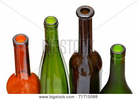 Bottlenecks Of Few Colored Wine Bottles Close Up