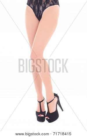 Long Sexy Female Legs In Shoes On Heels Isolated On White