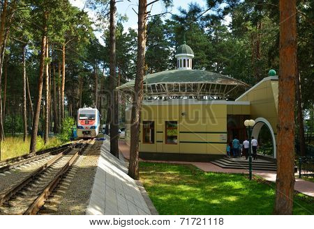 NOVOSIBIRSK, RUSSIA - AUGUST 20, 2014: Locomotive makes the maneuver on the station of Children's railway. Built in 2005 for about $9 millions, it is one of the best children's railroad in Russia