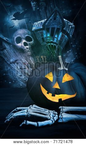 Black pumpkin with skeleton hand against eerie background