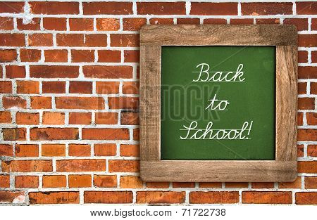 Chalkboard Over Red Brick Wall Background