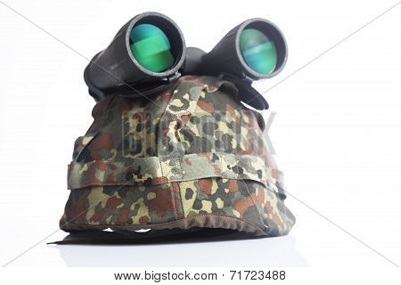 Military helmet and binoculars isolated on a white background
