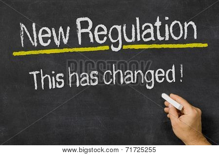 A blackboard with the text New Regulation